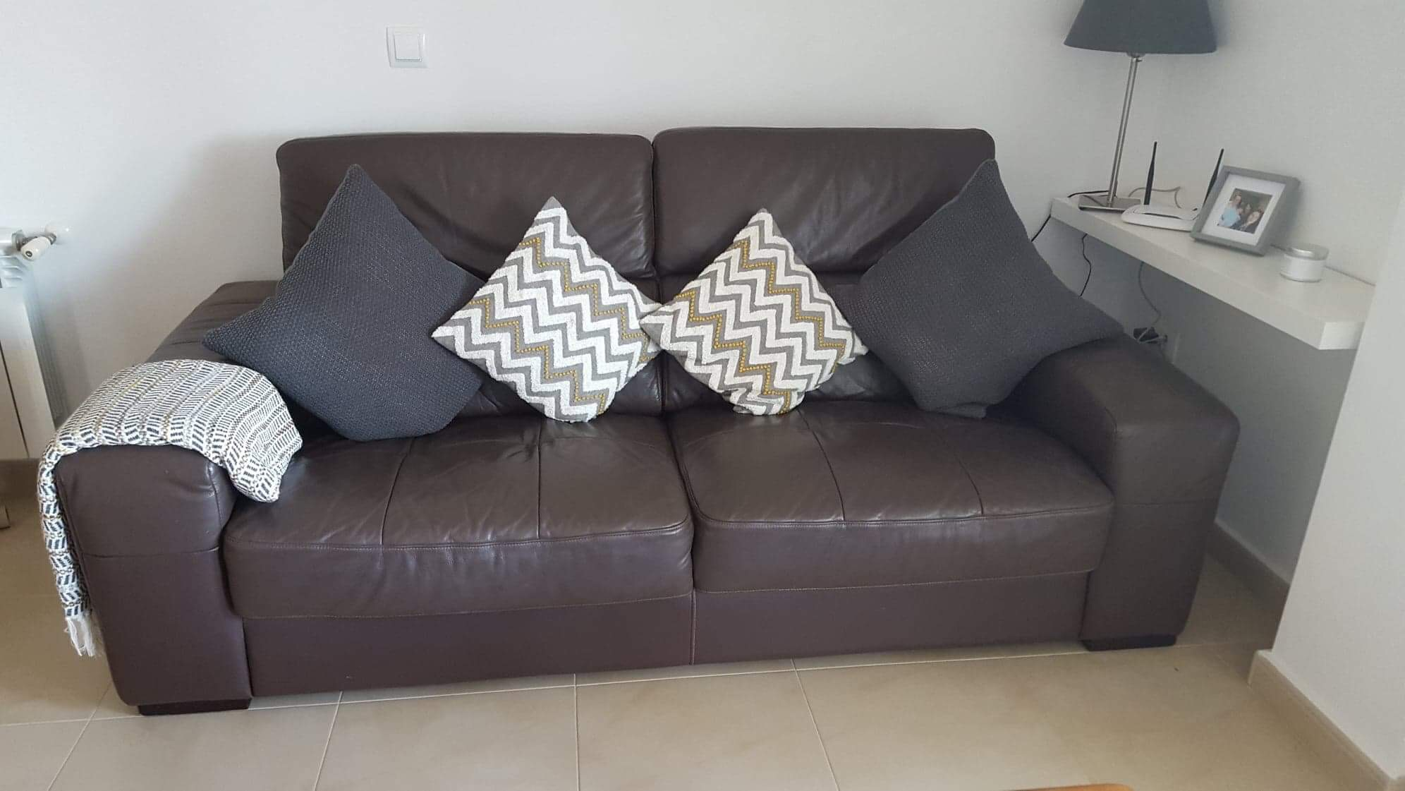For sale: Brown 2/3 seater leather sofa
