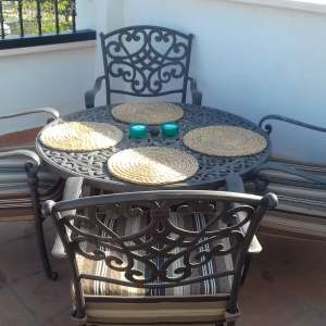 For sale: Wrought iron table and 4 chairs with fire pit - €250